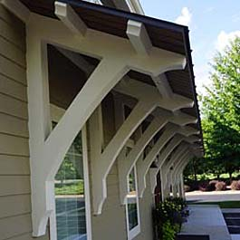 wood bracket supports for angled roof overhang - custom pitch