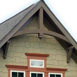 brown wood gable arch with two gable bracket supports