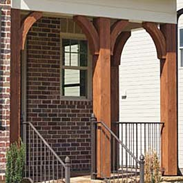 cedar brace arches in red stain