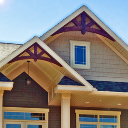 Dark stained cedar gable arches 10/12 pitch