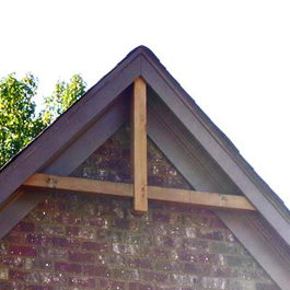 rustic cedar beam in gable unpainted