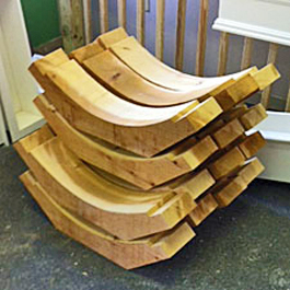 pile of large cedar braces after production