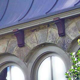 cedar soffit corbels in red stain