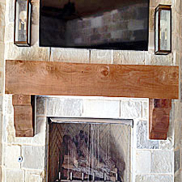 large cedar mantel corbels under large cedar mantel
