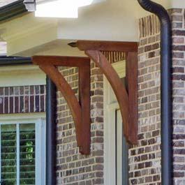 red cedar porch brackets under portico
