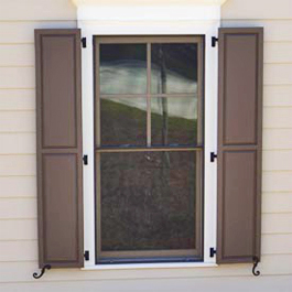 tall brown raised panel shutters on three hinges
