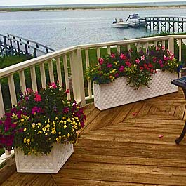 long lattice planters on curved back deck over looking lake