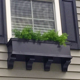 short black window box with four closely spaced brackets underneath