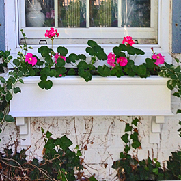 white traditional pvc window box with craftsman style bracket