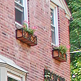 wrought iron window box with scrolls and copper liner