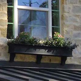 6' black window box on stone