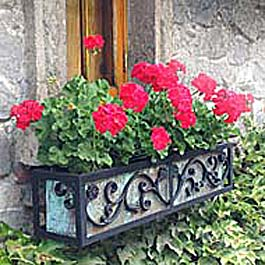wrought iron flower box with tarnish green copper