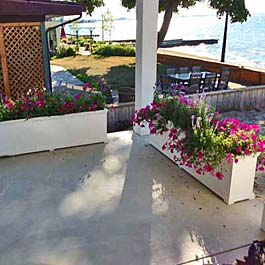 long, skiny planters defining boundaries of porch space
