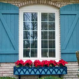 blue decorative window box with z batten shutters