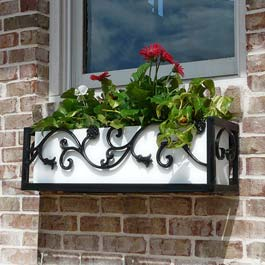 ornamental flower box with flower design on brick