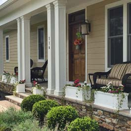 freestanding porch planters between front porch posts