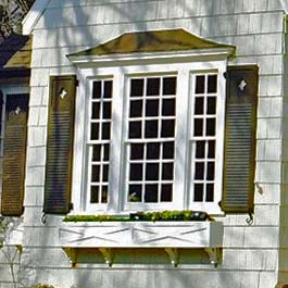 custom window box with x pattern on front with louver diamond cutout shutters