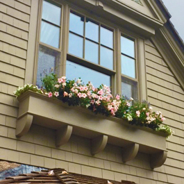 long custom window box installed atop rafter beams