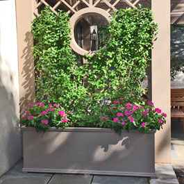 Brown Charleston planter with matching painted trellis display