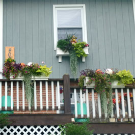 Window boxes and flower boxes on top of railings - back deck oasis