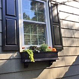 Small black window box with fall display