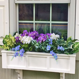 Blue delphiniums with white and purple peonies