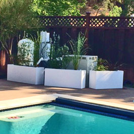 Large Modern planters poolside in front of pool system