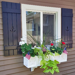 Wolfgang window box with our custom Board and Batten Shutters with Anchor Cutouts