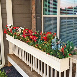 Christmas window boxes on front porch railings