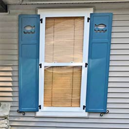 Composite Outdoor Shutters with Fish Cutout