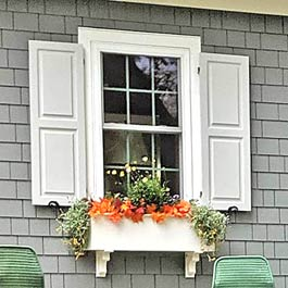 Grey Exterior Shutters and Flower Box on Cedar Shake Siding
