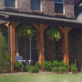 simple curved wood braces for front porch