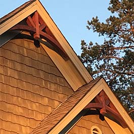 two red stained cedar gable arches 10/12 pitch