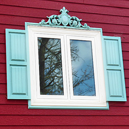 aqua blue shutters with bead board wainscot look and aqua window pediment