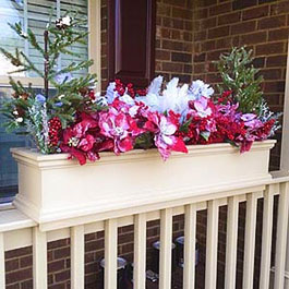 Winter artificial flower display for flower boxes on railings