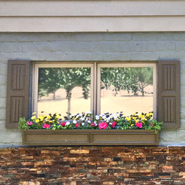 Brown Flower Box and Raised Wainscot Outdoor Shutters