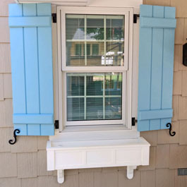 Baby Blue Board and Batten Shutters and Window Box