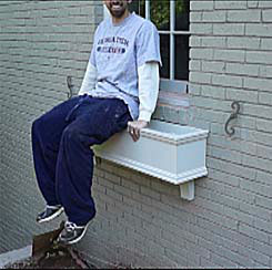 Man Sitting on Window Box