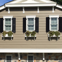 three window boxes on craftsman style home