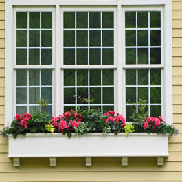 extra long window box with corbels underneath triple window