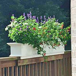 custom flower box on wood deck rail