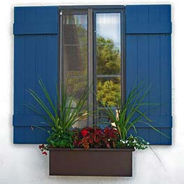 brown window box with blue shutters