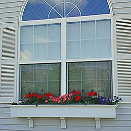 large double hung sunburst window with flower box