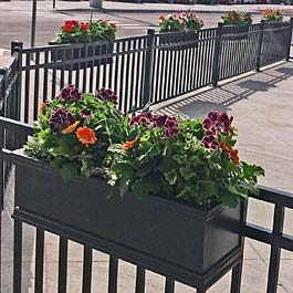 black railing planters on metal fence