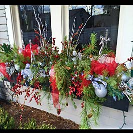 christmas ornaments in window box