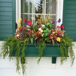 green winter window box with decorative flower arrangement